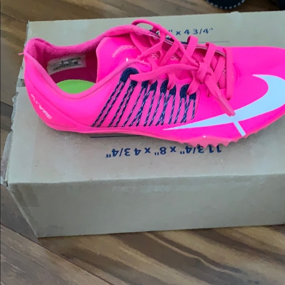 neon nike track spikes Shop Clothing